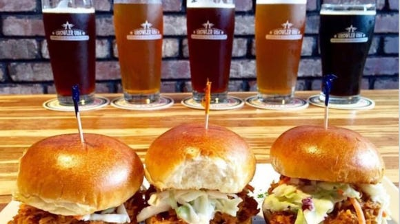 Growler USA offers more than 100 American beers on tap and a full pub menu.