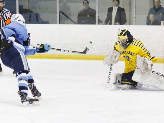 Hartland goalie Brett Tome stops a breakaway by Livonia