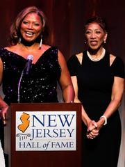 Queen Latifah thanks her family after being inducted into the N.J. Hall of Fame as her mother Rita Owens looks on during the induction ceremony at New Jersey Performing Arts Center in Newark, N.J., Sunday, June 5, 2011. (AP Photo/Rich Schultz)