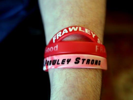 Liam Frawley wears wrist bracelets made for him July