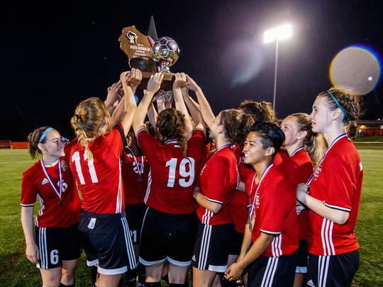 Wauwatosa East girls hoist the silver ball after placing second to Whitefish Bay in the WIAA Division 2 girls state soccer championship match at Uihlein Soccer Park in Milwaukee on Saturday, June 17, 2017.