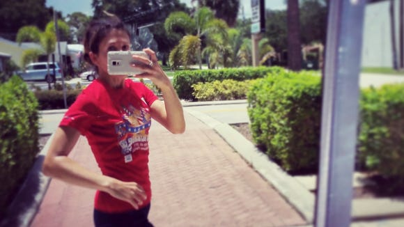Melissa Kastanias takes a photo while jogging.