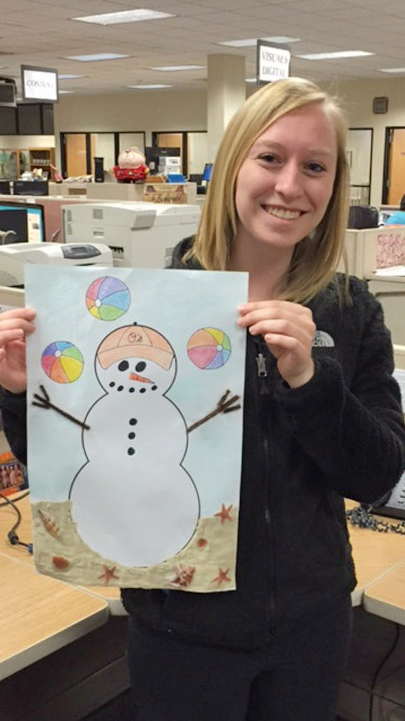 Abbey Zelko poses with her snowman, who juggles just like her!