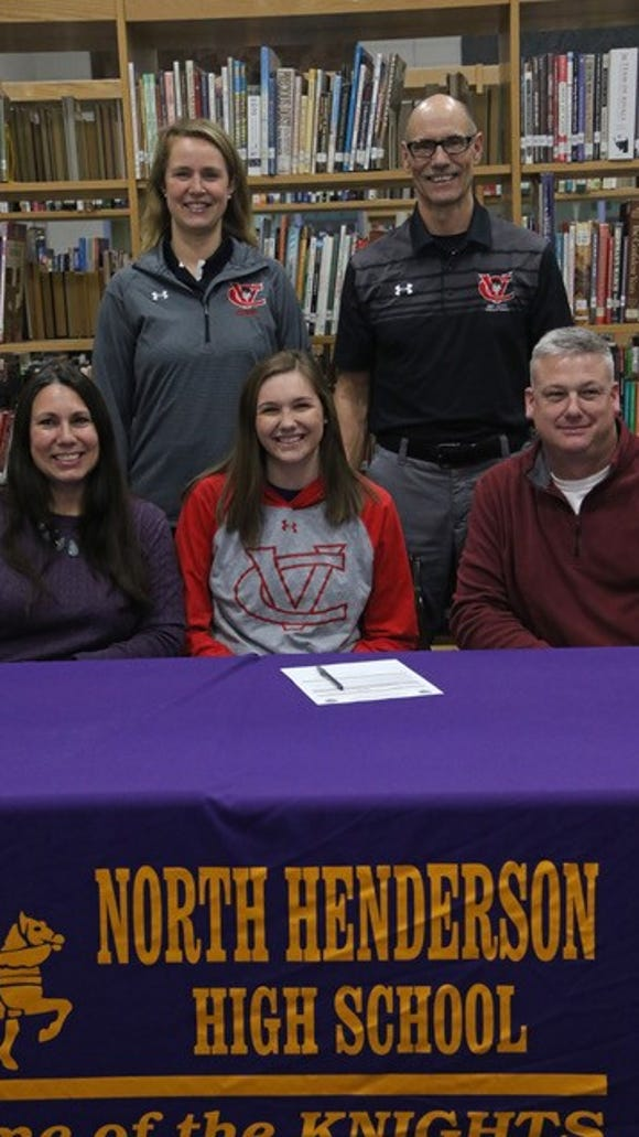 North Henderson's Zoe Phillips signed to play volleyball at Catawba Valley Community College Wednesday.
