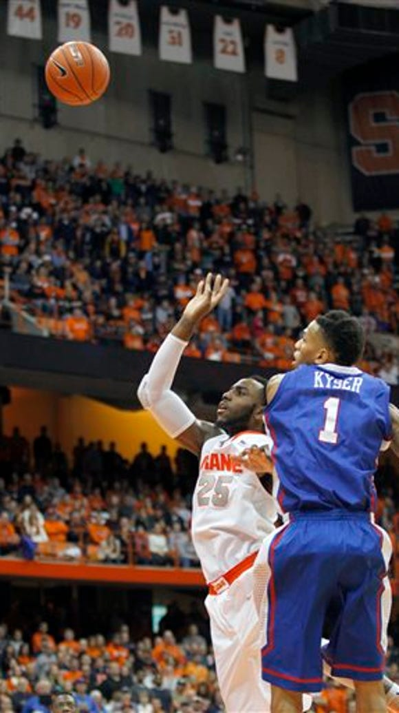 Syracuse's Rakeem Christmas, left, shoots the game