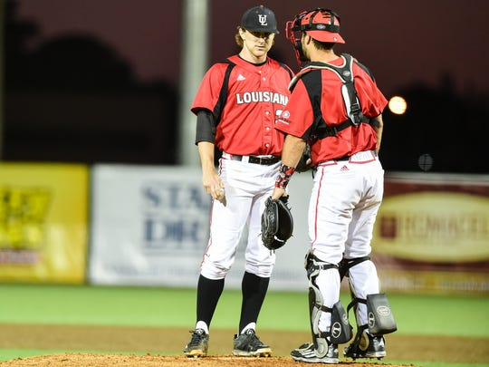 Starting pitcher Wyatt Marks  and Catcher Nick Thurman meet during UL's win over Georgia State on Thursday.