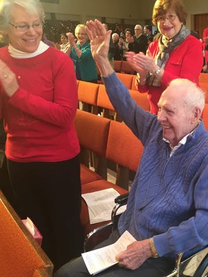 Vern Thayer thanks to the congregation at Lake Avenue Baptist Church on Sunday as it celebrated his 100th birthday. Beside him on his right is his daughter Marcia Kramer of Greece.