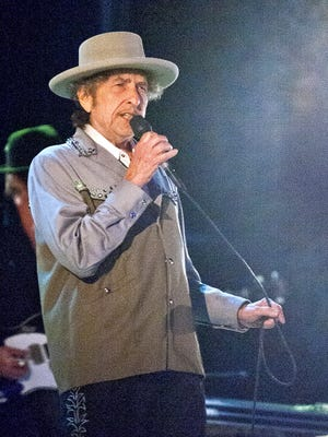 Bob Dylan performs at Bayfront Festival Park in Duluth, Minn., on Tuesday July 9, 2013 during a stop on the Americanarama Festival of Music.