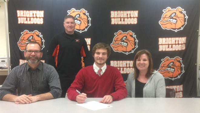 Connor Konas, front row center, plans to study physical therapy at the University of Indianapolis, where he is part of the school's first men's lacrosse team. With him are his parents Mark and Terri (seated) and Brighton coach Renn Moon (standing).