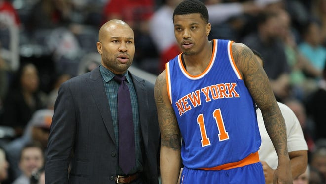 New York Knicks head coach Derek Fisher talks to guard Ricky Ledo (11) at a recent game.