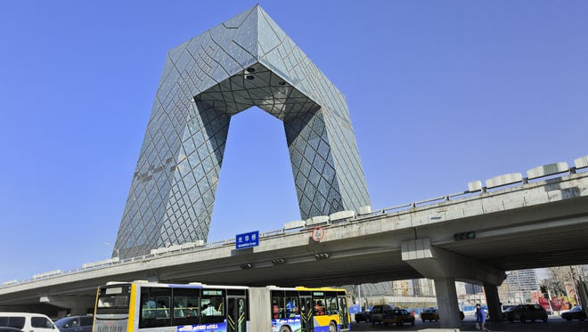 Instead of reaching for the sky, the CCTV Headquarters in Beijing wows visitors with an angular design of connected towers.