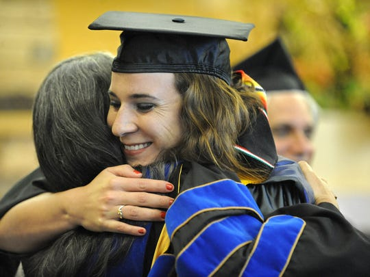 Teresita Giacaman hugs Emma Sepulveda after getting a certificate at  a special Latino Graduation ceremony held in the Joe Crowley Student Union at UNR on Monday, May 9, 2011. The event was organized by the school's Latino Research Center. Giacaman received a master's degree in literature.