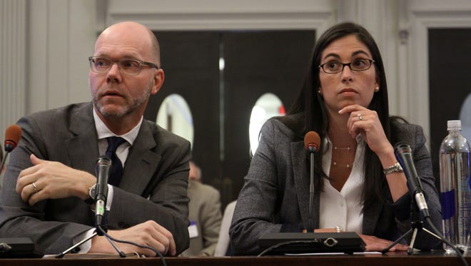 A former Christie administration official, Christina Renna, testifies May 6, 2014, before the New Jersey Legislative Select Committee on Investigation. At left is Renna's lawyer, Henry Klingeman.