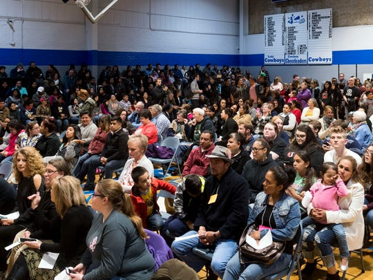 About 1000 people fill the gym Hillcrest Elementary School in Morristown, TN on Monday, April 9, 2018 for a prayer vigil in response to the detainment of immigrants after ICE raided Southeastern Provisions, a cattle slaughterhouse in Grainger County.