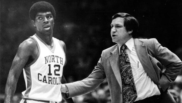 Phil Ford and former UNC basketball coach Dean Smith.
