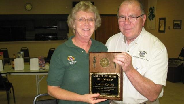 Elaine Colton, left, receives recognition for becoming a Knight of Sight from Phil Weber, District B1 Director for the Lions Eye Bank of Wisconsin.