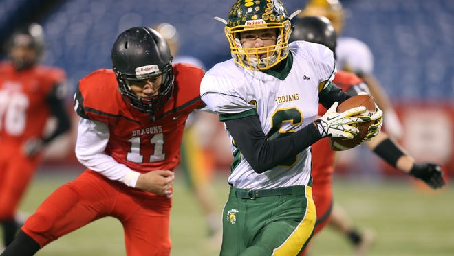 Alexander's Derrick Busch (6)  looks for running room after a short catch against Maple Grove's Mitch Padilla (11).