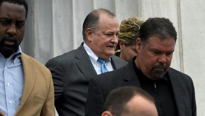 Mark Hazelwood, center, leaves the Joel W. Solomon Federal Courthouse in Chattanooga on Wednesday, Feb. 14, 2018. The former Pilot Flying J president was convicted Thursday of conspiracy to commit wire and mail fraud, witness tampering and one individual count of fraud.