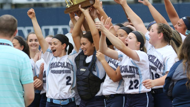From 2017: Gabby Fredette (#2) and her Immaculate Conception teammates celebrate beating, Wildwood Catholic in the State Non-Public B Softball Championship in Union, Sunday June 4, 2017.  I.C. became the first team in New Jersey history to win five straight state titles.