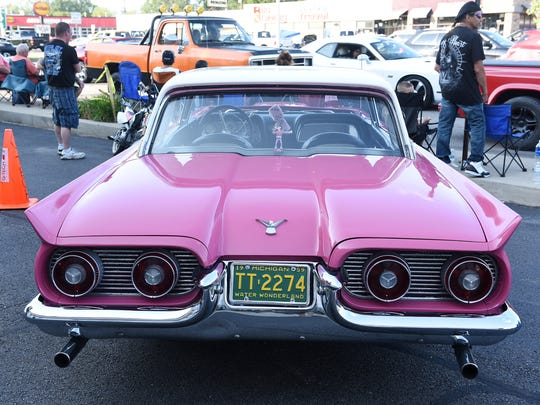 A very pink 1959 Ford Thunderbird during the Woodward Dream Cruise on Woodward Avenue in Royal Oak, Mich. on Aug. 19, 2017. 
