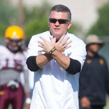 ASU head coach Todd Graham signs to his team during football practice at Kajikawa Practice Fields in Tempe on August 8, 2014.