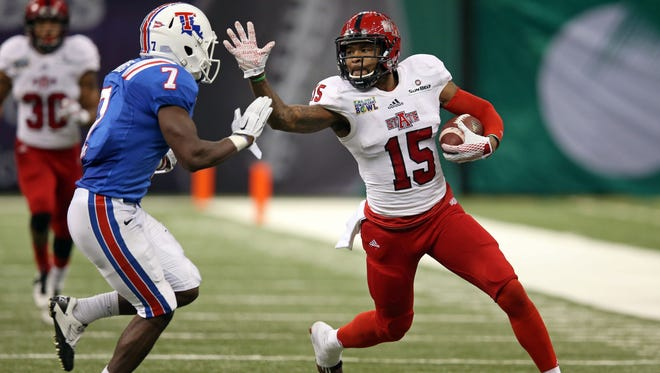Arkansas State Red Wolves wide receiver Tres Houston (15) prepares to stiff-arm Louisiana Tech Bulldogs safety Xavier Woods (7) in the third quarter of the 2015 New Orleans Bowl at the Mercedes-Benz Superdome. Louisiana Tech won, 47-28.