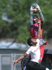 Cooper receiver Myller Royals, top, makes a touchdown grab over a San Angelo Central defender at the Abilene 7-on-7 Division I State Qualifier on June 9, 2017 at McMurry's Wilford Moore Stadium.
