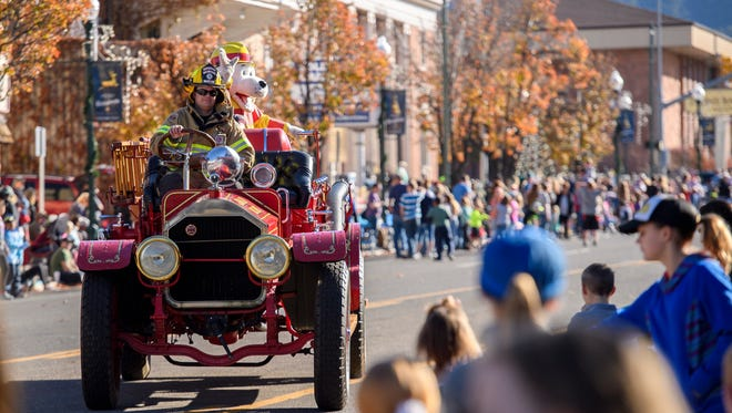 The Cedar City Fire Department drives a classic fire truck in the Storybook Cavalcade on Main Street in Cedar City Saturday, November 17, 2018.