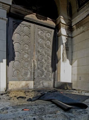 The handmade doors of Lancaster City Hall were torched on May 23, 2018. They were made in the 1800s, police said.