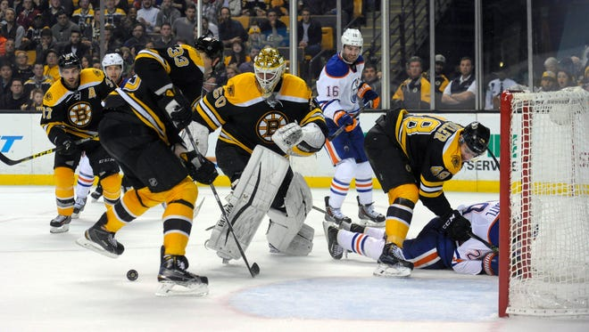 Boston Bruins defenseman Zdeno Chara (33) tries to clear the puck in from of goalie Jonas Gustavsson (50) during the third period against the Edmonton Oilers at TD Garden.