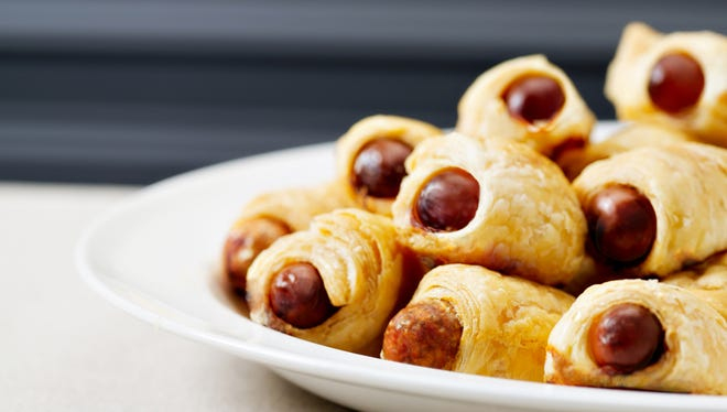 """The """"pigs in a blanket"""" served by Brooklyn Piggies in New York brings the kids' favorite dish to new gourmet heights."""