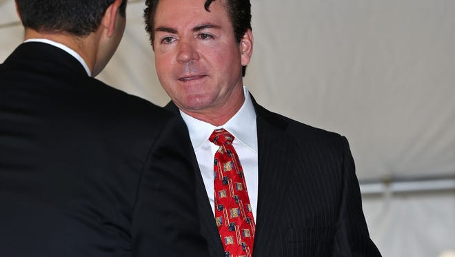 Papa John's founder and CEO John Schnatter, right, shakes hands with St Vincent CEO Jonathan Nalli after the program for the groundbreaking ceremony for the St. Vincent House at St. Vincent, Thursday, October 22, 2015.  Schnatter donated $1 million to the project.