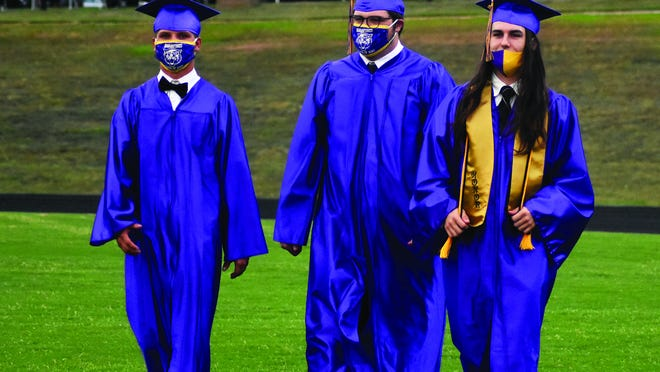 These guys still know their way around Bearcat Stadium. Andrew Robertson, Cort Mizell, and Cam Brasher walk toward the graduate seating area prior to Thursday's commencement exercise for the Booneville High School Class of 2020.