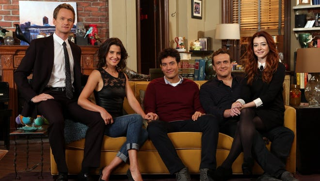 The original five cast members of 'How I Met Your Mother' -- Neil Patrick Harris, Cobie Smulders, Josh Radnor, Jason Segel, and Alyson Hannigan  -- huddle on the couch in the apartment, which has been home to almost everyone at some point in the series. (Harris' Barney is the only exception.)