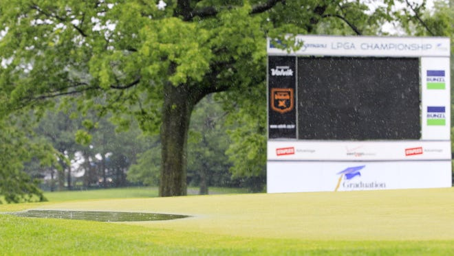 A general view of a puddle of water on the 18th green after the first round of the Wegmans LPGA championship was canceled because of rain at the Locust Hill Country Club on June 6, 2013.