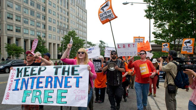 Protesters hold a rally in May at the Federal Communications Commission for Net Neutrality.