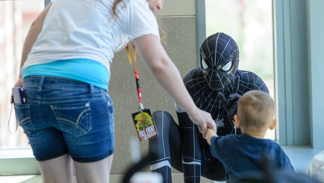 Conner Robertson, 18 months old from Tucson, meets Venom on the final day of Comicon on May 28, 2017, at the Phoenix Convention Center in downtown Phoenix.