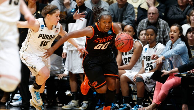 Oklahoma State Cowgirls guard Roshunda Johnson (00) brings the ball up court in the second half of a women's basketball against Purdue Boilermakers guard Hayden Hamby (10) in the second round of the NCAA Tournament at Mackey Arena. Oklahoma State defeats Purdue 73-66.