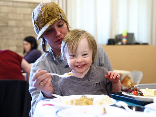 Amanda Kanehl and Jett Kanehl, 3, of western Des Moines eat together Monday, Nov. 21, 2016, during the Thanksgiving Feast at Smouse Opportunity School in Des Moines.