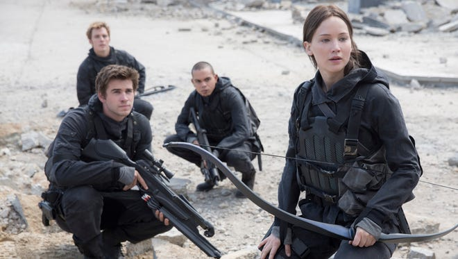 "This photo provided by Lionsgate shows, Liam Hemsworth, left, as Gale Hawthorne, Sam Clafin, back left, as Finnick Odair, Evan Ross, back right, as Messalia, and Jennifer Lawrence, right, as Katniss Everdeen, in the film, ""The Hunger Games: Mockingjay - Part 2.""  The movie opens in U.S. theaters on Nov. 20, 2015."