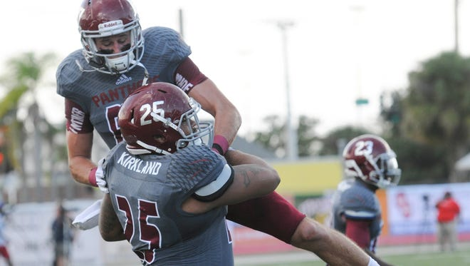 Florida Tech's Kenny Johnston celebrates with Tevin Kirkland who scored a TD during Saturday's game against West Georgia.