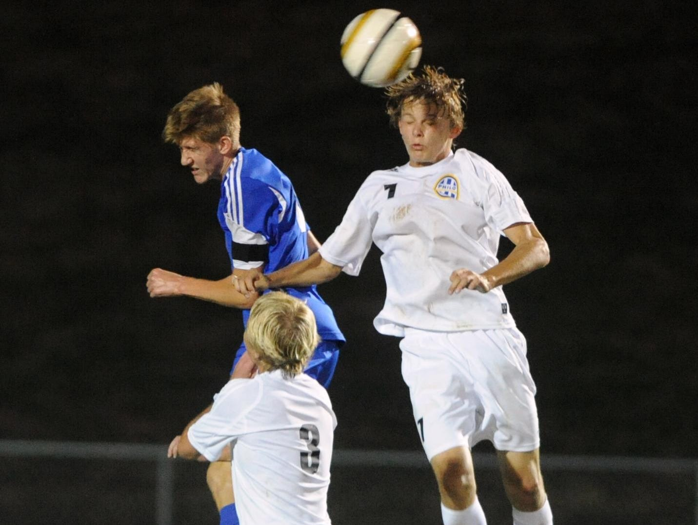 Philo's Wyatt Carder and West Muskingum's Jeremy Moore leap to head a ball during West M's 4-1 victory over Philo on Tuesday in Duncan Falls.