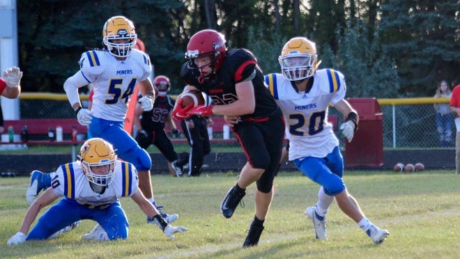 Devils Lake sophomore Colton Schneider breaks free from a tackle during a game against Beulah on Sept. 4 at Joe Roller Field. The Firebirds lost to the Miners, 35-0.