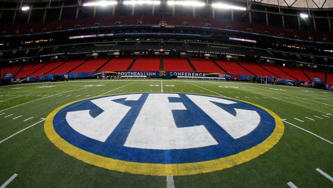In this Dec. 5, 2014, file photo, the SEC logo is displayed on the field ahead of the Southeastern Conference championship football game between Alabama and Missouri in Atlanta