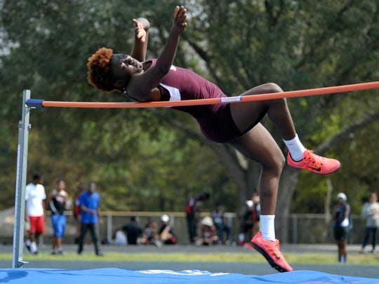 Malainna White of Pensacola High competes in the high jump during the 2015 Panhandle Championships track meet held Saturday at Washington High.