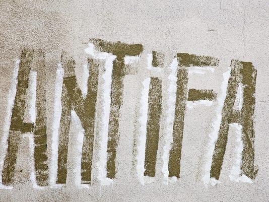 Antifa graffiti on wall.