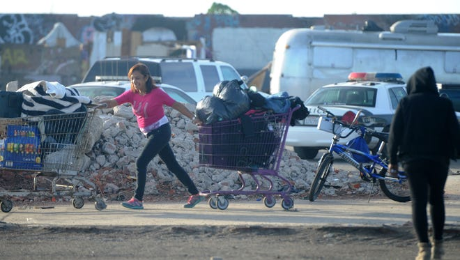 People who had been living in a homeless encampment in Oxnard gather their belongings to move out in this Star file photo.