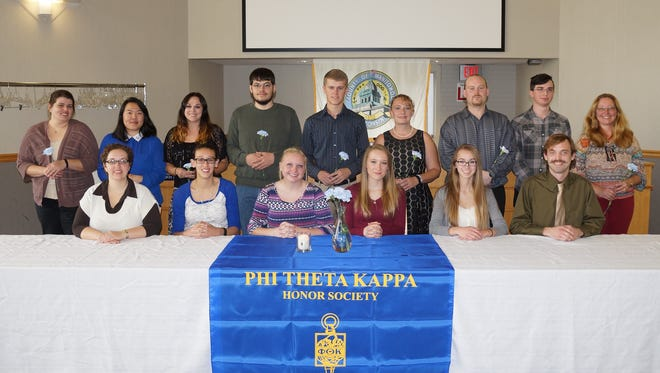 Front row, from left: adviser Amy Kabrhel and officers Melissa Khalil, Tori Cretton, Paige Arneson, Sylvia Stuebs and Dan Mrotek; back row, from left: inductees Tricia Vohwinkel (Manitowoc), Maya Lee (Manitowoc), Kimberly Swetlik (Two Rivers), David Krause (Newton), Samuel Schneider (Manitowoc), Lori Yaeger (Valders), James Gremore (Manitowoc), Austin Bohling (Two Rivers), Catherine Hinkle (Reedsville). Not pictured are Cameron Polifka (Manitowoc) and Parker Wood (Manitowoc).
