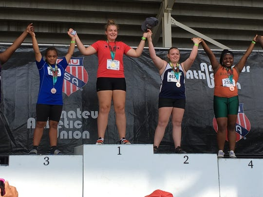 Farmington resident Valadian Pallett (center atop podium)
