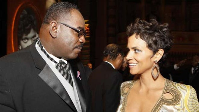 General Holiefield, UAW vice president and NAACP national board member, greets actress Halle Berry, who won an Image Award in 2011. He died of cancer in 2015.